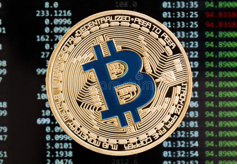 Golden bitcoin cryptocurrency blue coin on a circuit board backg stock photo