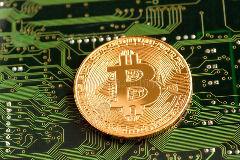 Golden Bitcoin Cryptocurrency on circuit board. royalty free stock photo