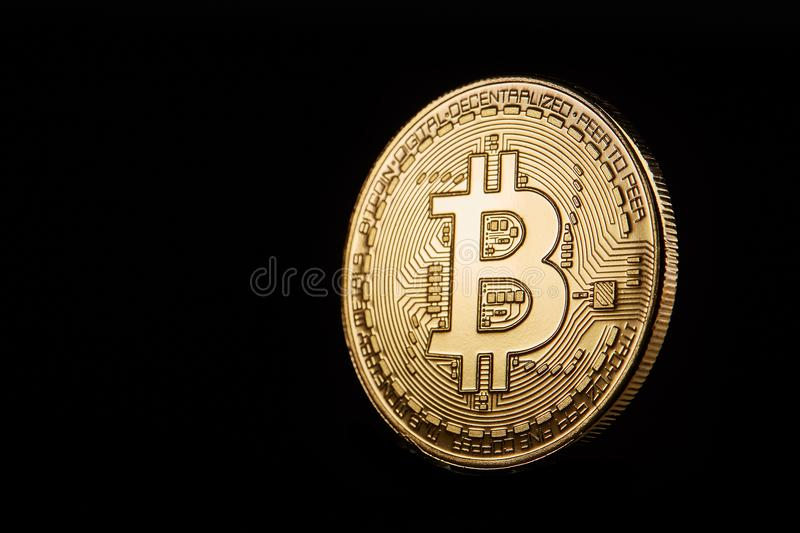 Golden bitcoin cryptocurrency coin isolated on black background, shallow depth of field royalty free stock image