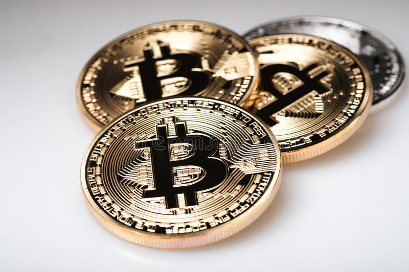 Golden bitcoin cryptocurrency on white background stock image