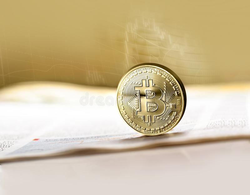 Golden Bitcoin. Electronic money exchange concept. Physical version of Bitcoin virtual money. Digital payment system cryptocurrency concept stock photography