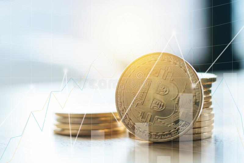 golden bitcoin with growing graph, concept as finance, trade and stock photo