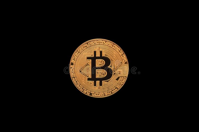 Golden bitcoin isolated on black background stock image