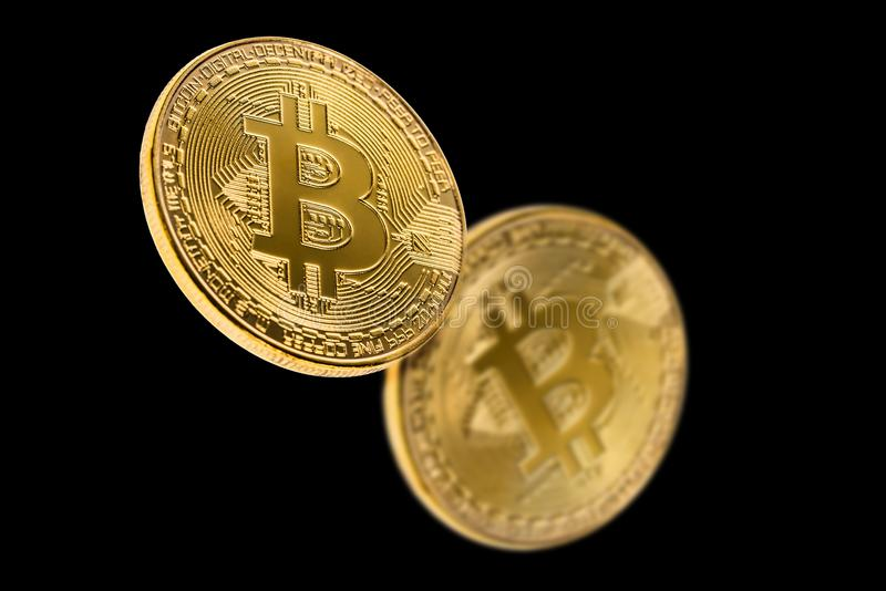 Golden bitcoin isolated on a black background with reflection. Cryptocurrency concept. royalty free stock image