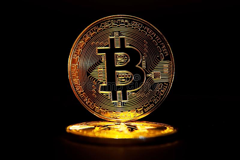 Golden Bitcoin isolated on black background royalty free stock photo