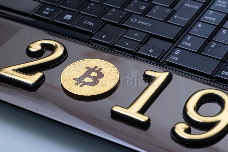 Golden bitcoin. It lies on the laptop. inscription 2019. Business currency keyboard trade web bank cash electronic financial mining money payment symbol virtual royalty free stock image