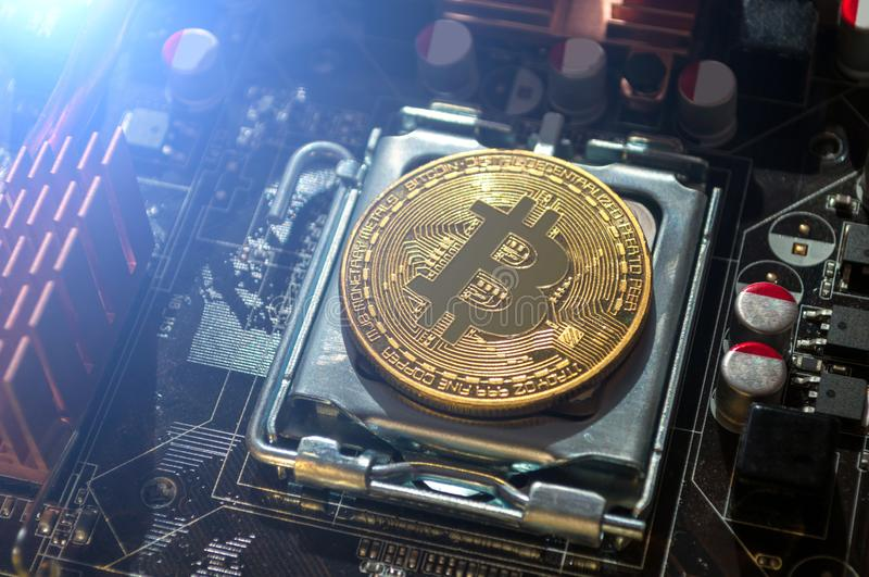 Golden bitcoin lying on the electronic computer component. Business concept of bitcoin mining and digital cryptocurrency stock photos