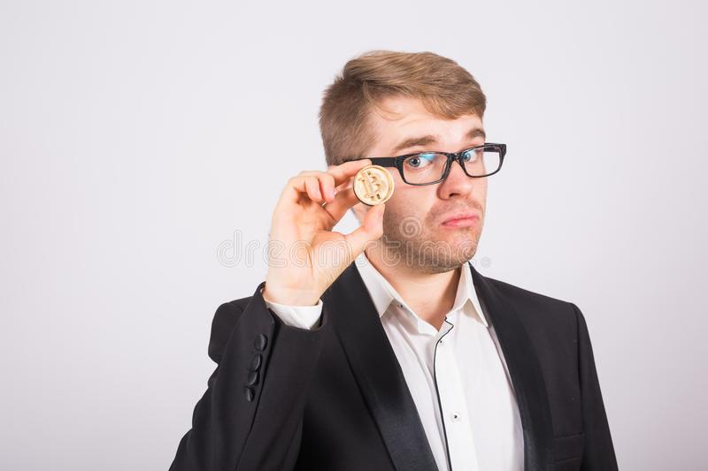 Bitcoin in a man hand, Digital symbol of a virtual cryptocurrency. Golden Bitcoin in a man hand, Digital symbol of a virtual cryptocurrency royalty free stock image