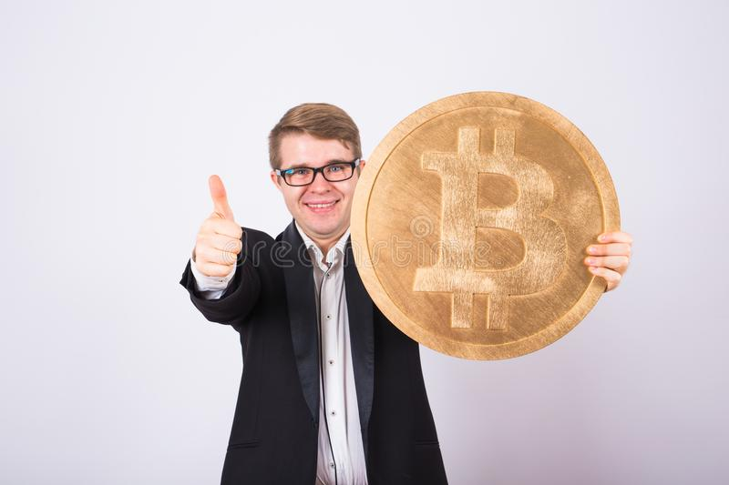 Golden Bitcoin in a man hand, Digital symbol of a virtual cryptocurrency. Golden Bitcoin in a man hand, Digital symbol of a virtual cryptocurrency stock images