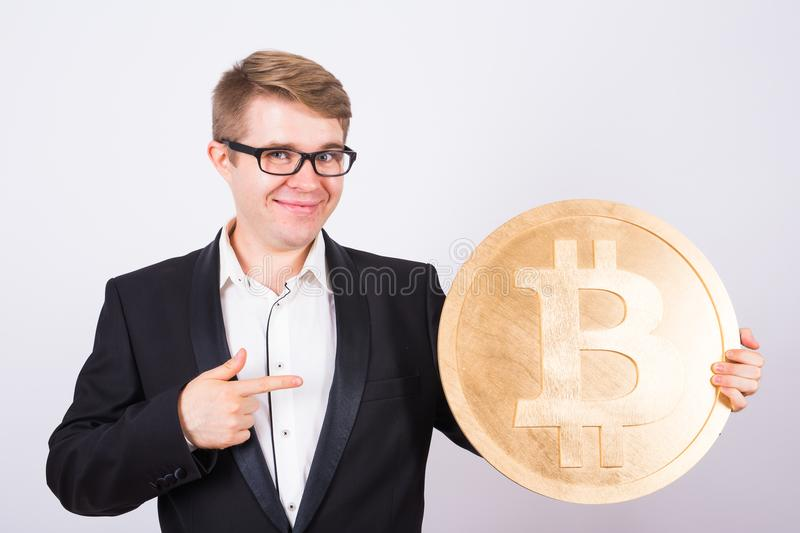 Golden Bitcoin in a man hand, Digital symbol of a virtual cryptocurrency. Golden Bitcoin in a man hand, Digital symbol of a virtual cryptocurrency stock photo