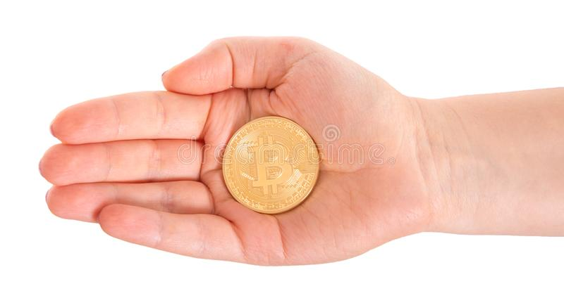 Golden Bitcoin in a man hand. Digitall symbol of a new virtual c royalty free stock images