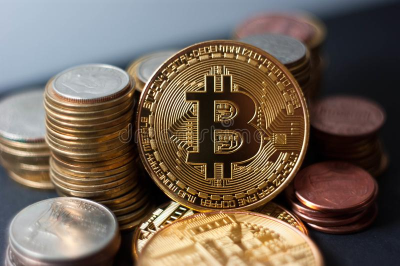 Golden bitcoin with money coins background. Bit coin cryptocurrency banking money transfer business technology stock images