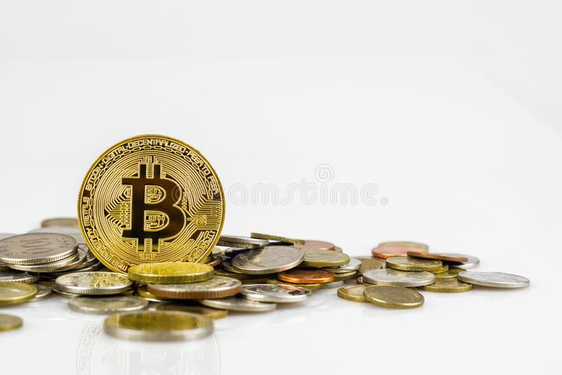 Golden bitcoin over many international money coins isolated on white background.  Crypto currency concept.  Bitcoin cryptocurrency royalty free stock photos