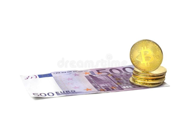 A golden bitcoin stack on a five hundred euro banknote. Cryptocurrency, Digital currency with 500 Euro bills. Bitcoin exchange and stock images