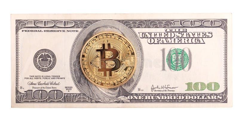 Golden Bitcoin on US dollar. stock photos
