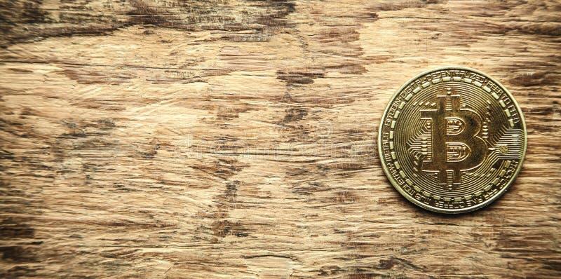 Golden bitcoin on wooden desk. royalty free stock photos
