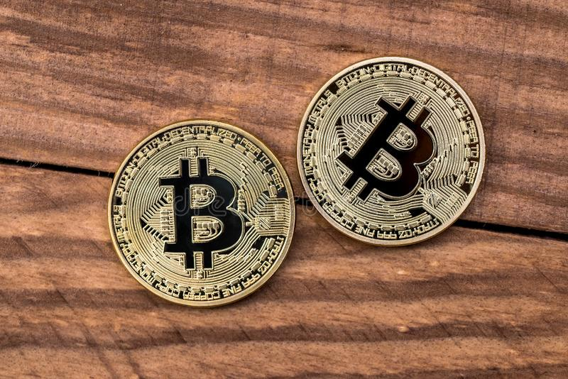Golden bitcoin on wooden desk. Close up royalty free stock images