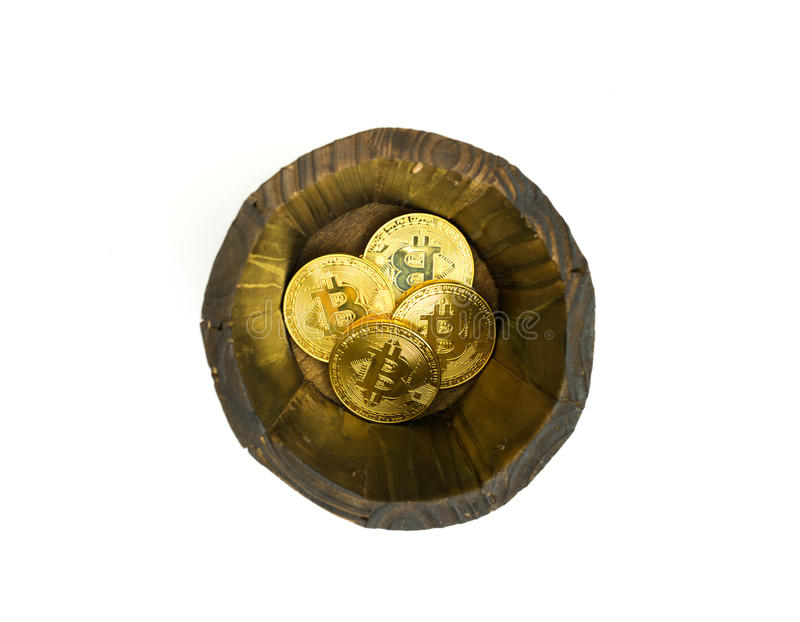 Golden Bitcoins in barrel. Digital symbol of a new virtual currency on isolate background. Golden Bitcoins in barrel. Digital symbol of a new virtual currency stock photography