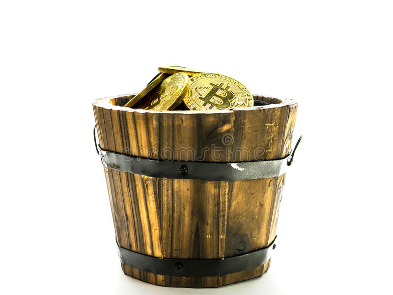 Golden Bitcoins in barrel. Digital symbol of a new virtual currency on isolate background. Golden Bitcoins in barrel. Digital symbol of a new virtual currency royalty free stock photo