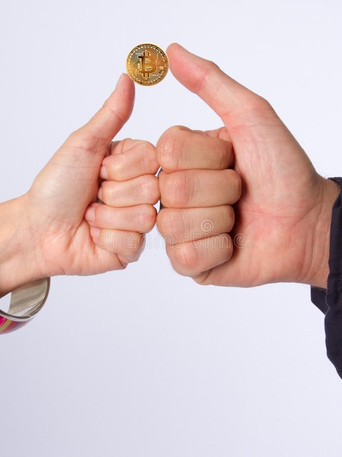 Golden bitcoins in hand. Digital symbol. Of a new virtual currency deal on white background royalty free stock photo