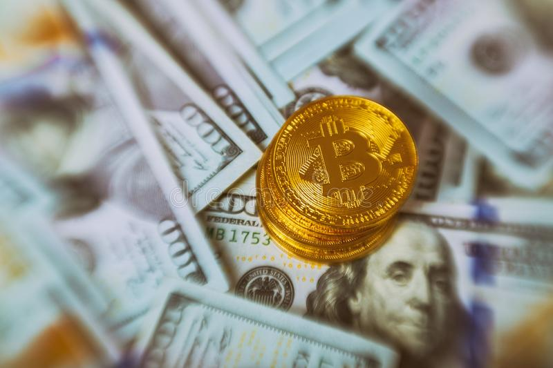 Golden Bitcoins on US dollars for background. Bitcoin digital currency close-up. New Virtual money concept. Crypto currency top vi stock photography