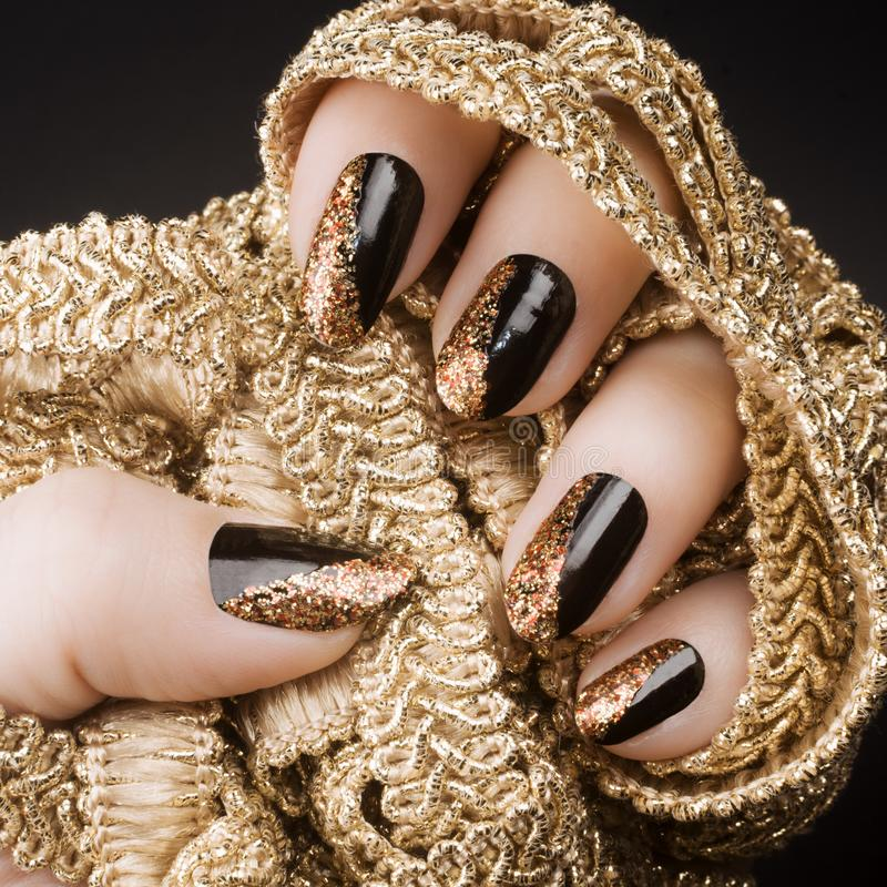 Golden black nails royalty free stock image