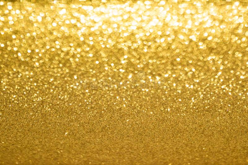 Golden blurred background. Blurred golden background of glitter illusion royalty free stock photography