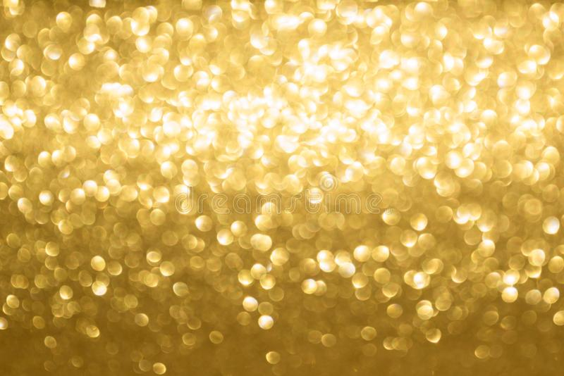 Golden blurred background. Blurred golden background of glitter illusion stock photos