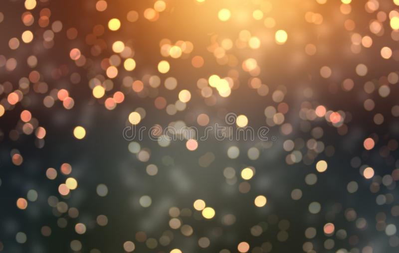 Golden bokeh blurred onblack background. Gold flash on top. Stylish luxury glitter background. Festive confetti texture. Sparkling stock images