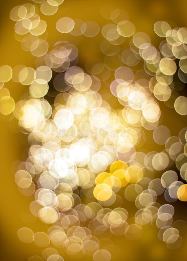 Golden bokeh light effect. Bokeh golden light effect defocused circle patterns on dark background stock photo