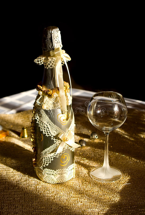 Download Golden Bottle Champaign And Empty Goblet Royalty Free Stock Image - Image: 12762486