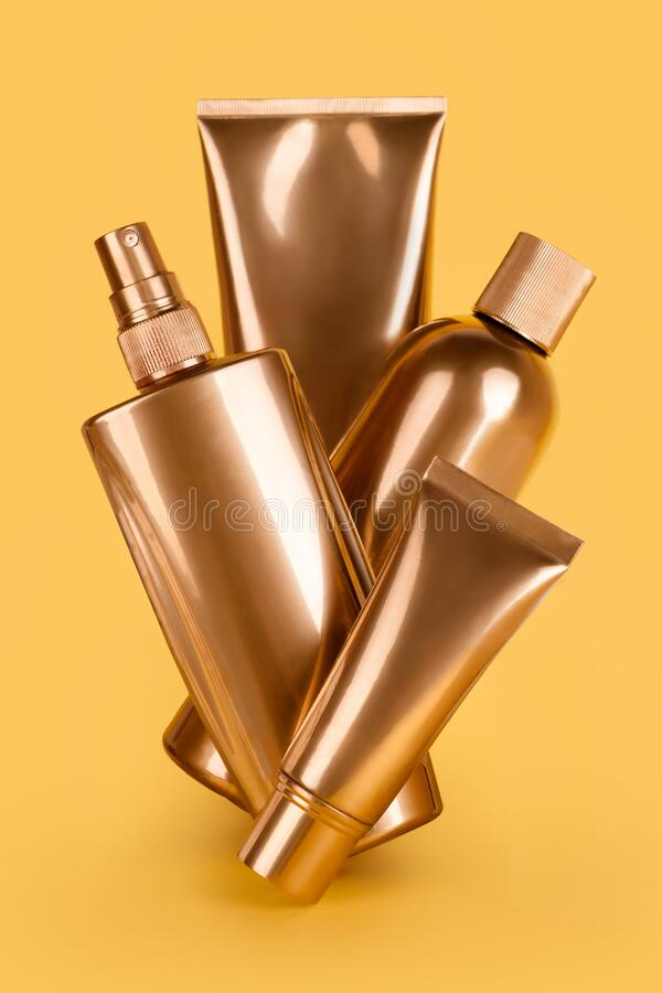 Free Golden Bottles, Cosmetic Products On Yellow Background. Luxury Beauty Style. Gold Cosmetic Containers. Mockup Bottles, Cosmetics Royalty Free Stock Image - 214739076