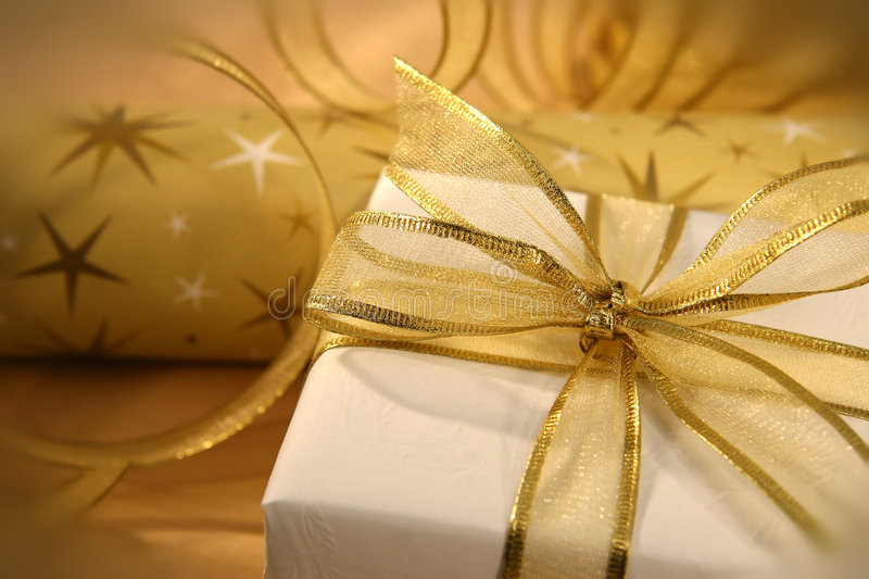 Golden bow. Gold bow on holiday wrapping stock image