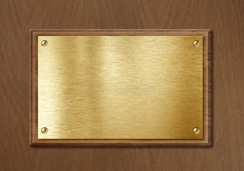 Golden or brass plate for nameboard or diploma background frame. Golden or brass plate for nameboard or diploma background in wooden frame stock image