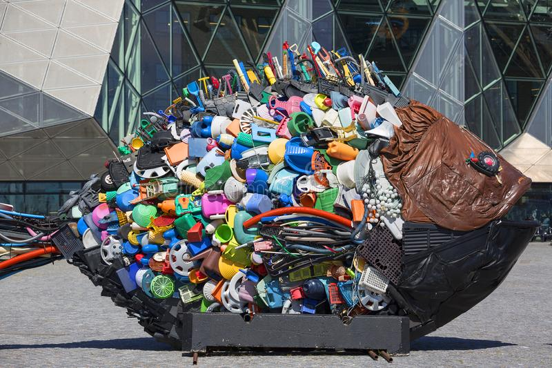 Golden bream, sculpture in the shape of a fish, created by plastic waste from the sea in Helsingor, Danmark. HELSINGOR, DENMARK - JULNE23, 2019: Golden bream stock photo