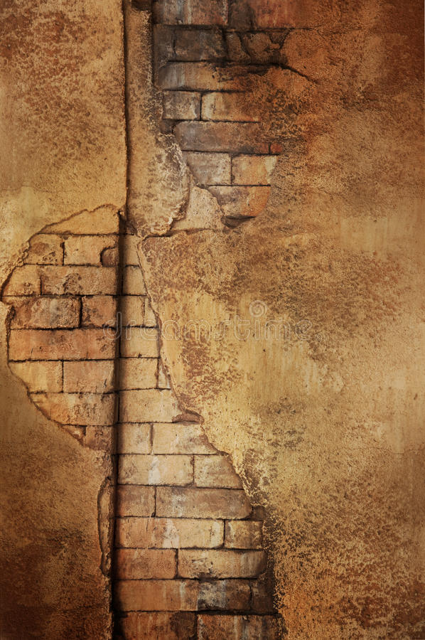 Golden brick wall. A golden brick wall with the surface marred and broken royalty free stock images