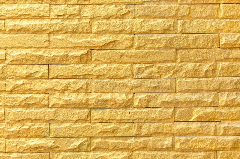 Golden brick wall background pattern texture.  royalty free stock photo