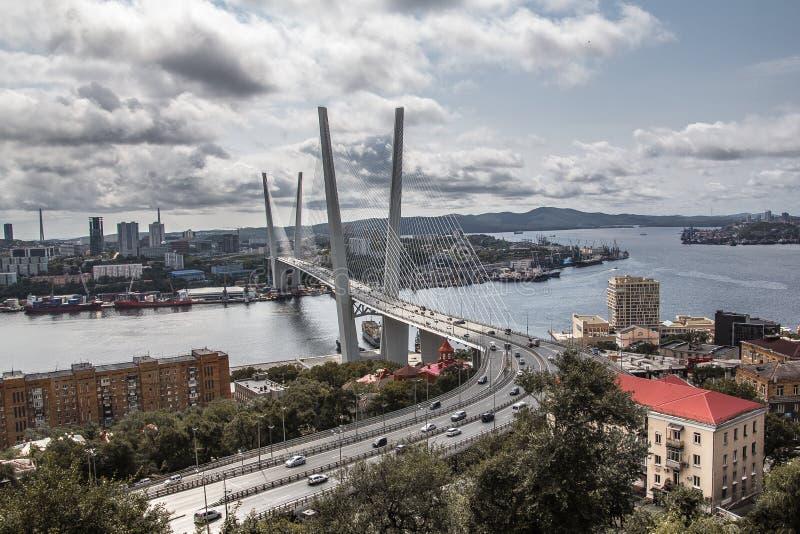 Golden bridge in Vladivostok. Vansu bridge. architecture. sky. landscape. panorama. clouds. City. At home. Concrete jungle. Stunning views of the horizon, from royalty free stock photos