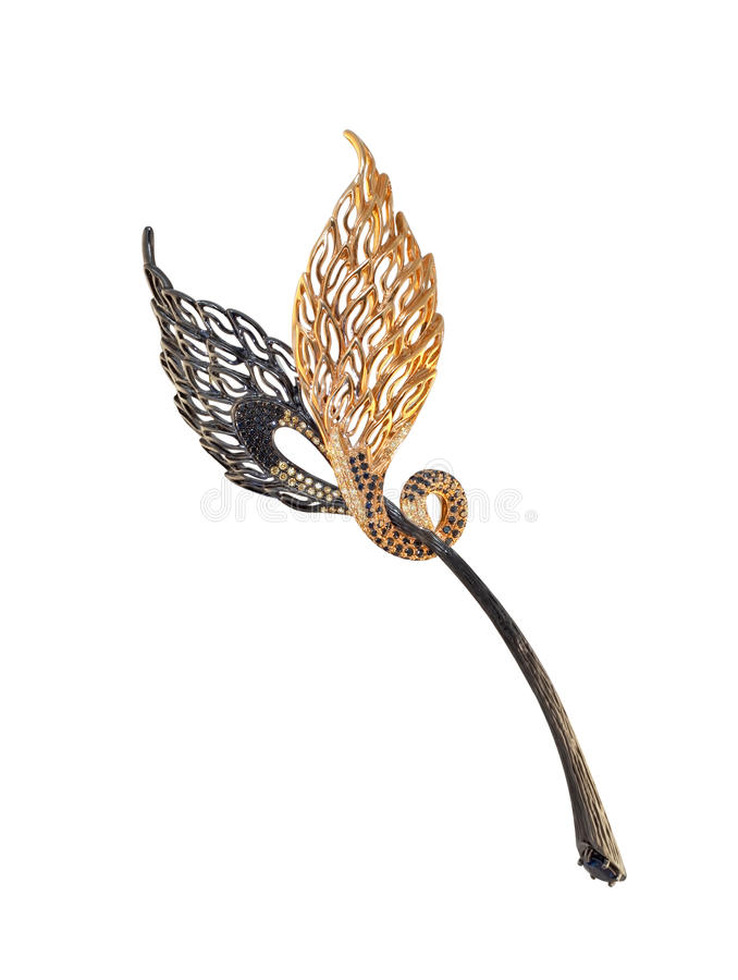 Golden brooch with black and yellow diamonds on a white royalty free stock images