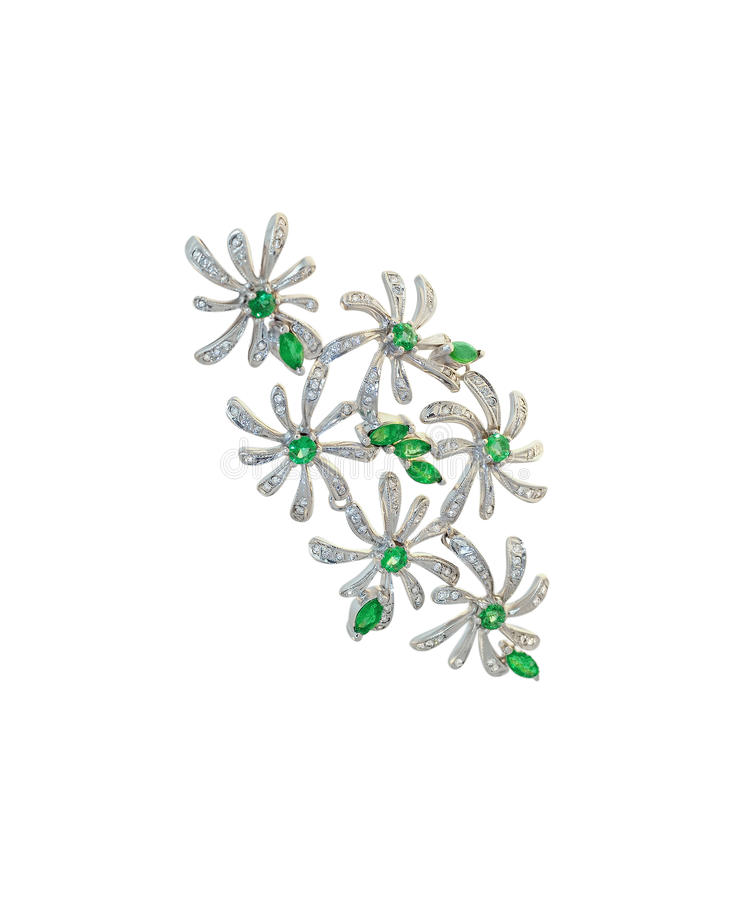 Golden brooch with diamonds and emeralds stock image