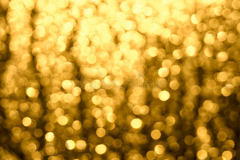 Golden-brown background with abstract blurred highlights. Bokeh in blur. Horizontal shot of golden-brown background with abstract blurred highlights. Bokeh in stock images