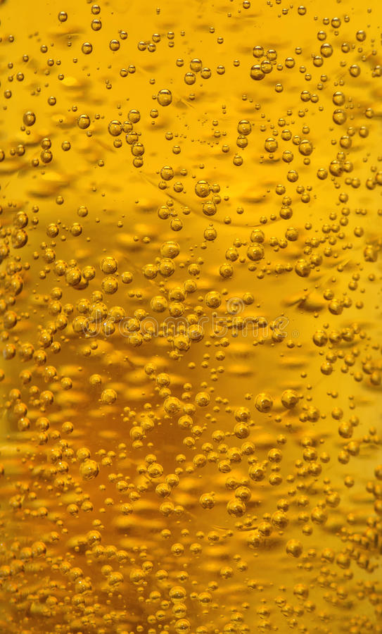 Golden bubbles of beer texture stock images