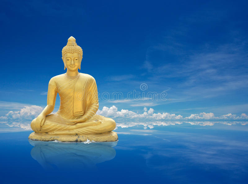 Golden buddha. With abstract background stock photos