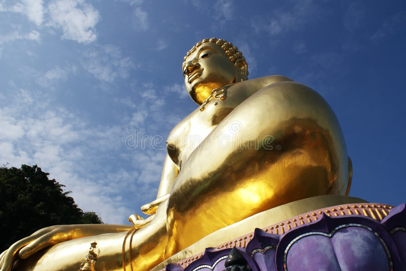 Golden Buddha. With blue sky was shot at Golden Triangle, Thailand stock image