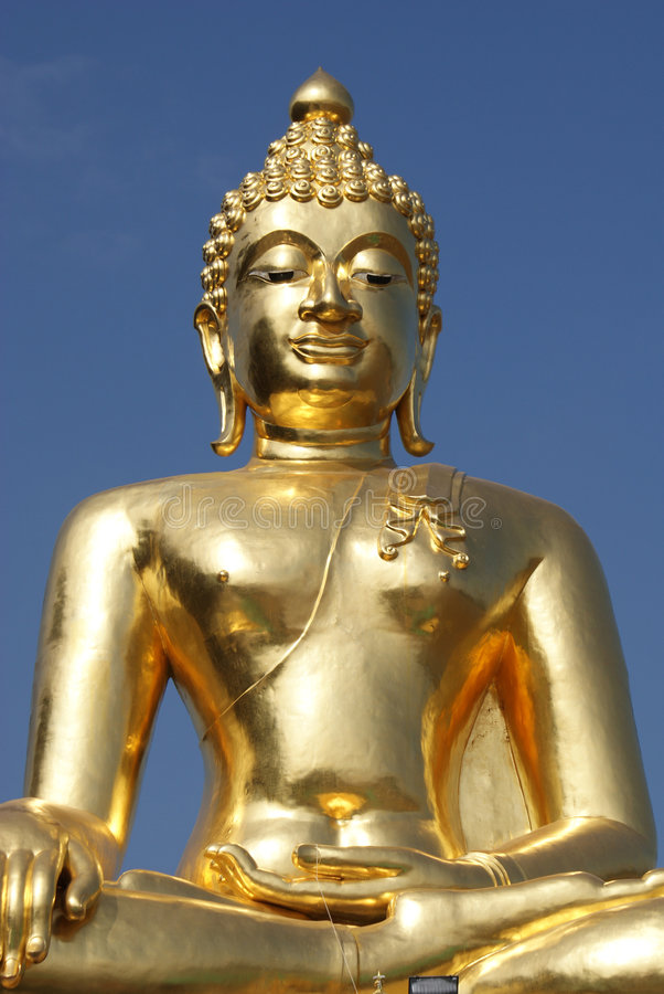 Golden Buddha. With blue sky was shot at Golden Triangle, Thailand royalty free stock image