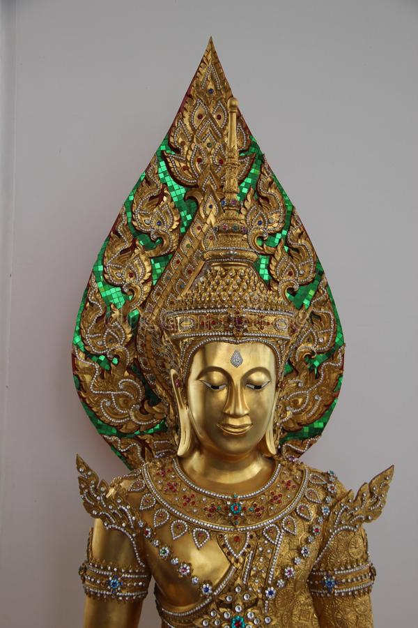 Golden Buddha Decorated With Jewelry royalty free stock photo