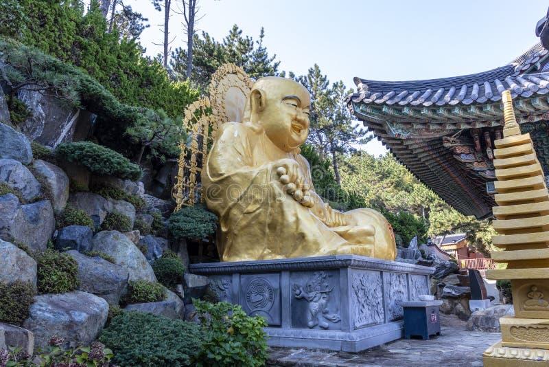 Golden Buddha of the Haedong Yonggungsa buddhist monastery in Busan, South Korea. Asia royalty free stock photo