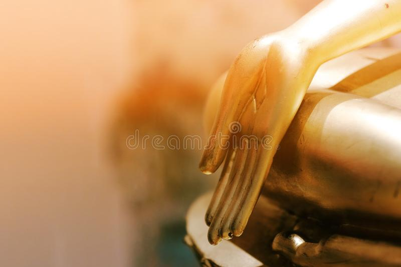 Golden Buddha hand in the temple royalty free stock photo