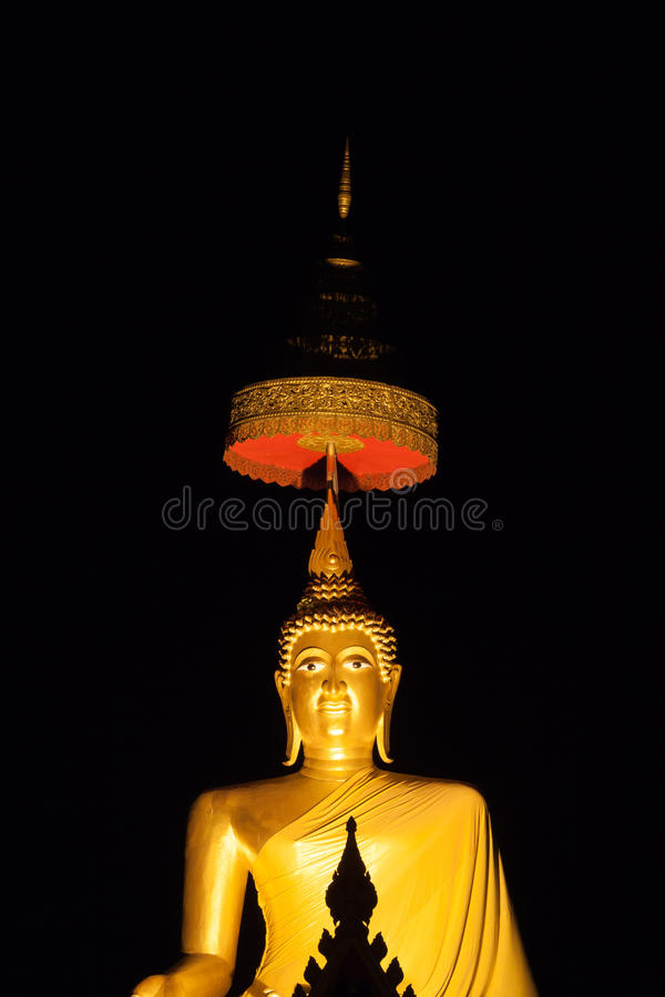 Golden buddha image with night time. In thai temple royalty free stock images