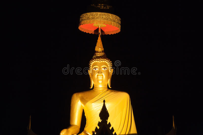 Golden buddha image with night time. In thai temple stock photos
